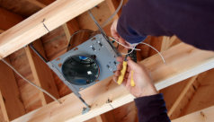 electrician installing light system