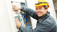 electrician checking the electric meter