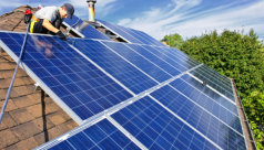engineer installing solar panel